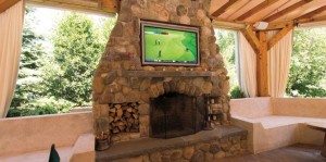 outdoor-living-room-flatscreen-tv-mounted-in-stone-fireplace-greenwich-ct-668x332_1